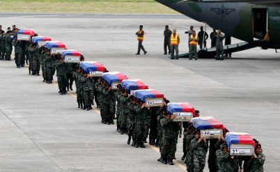 Filipino elite cops remains arrive in Manila